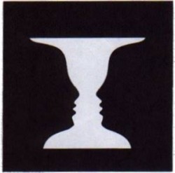 Famous Figure-Ground image. Do you see faces or a vase? Most people can see either at will.